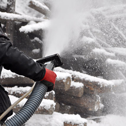 Spraying artificial snow effects